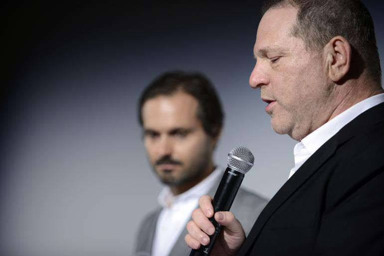 Le producteur Harvey Weinstein et l'acteur Ned Benson lors d'une conférence de presse de la Weinstein Company and World View Entertainment, lors du 67ème festival de Cannes, (France), vendredi 16 mai 2014.