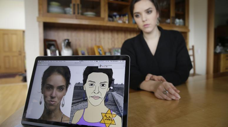 Erin Schrode poses behind a laptop displaying anti-Semitic images of herself that she received in her email and social media at her home in Mill Valley, Calif. Less than a week before the election for her long-shot congressional campaign, Schrode woke up in her northern California home, rolled over in bed and reflexively checked her cellphone. The 25-year-old activist burst into tears when she found a barrage of anti-Semitic emails.